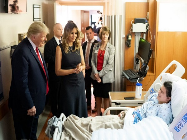 US President Donald Trump and First Lady Melania Trump meets a shooting victim at a hospital in Dayton on Wednesday. (Picture Credits: Trump's Twitter)