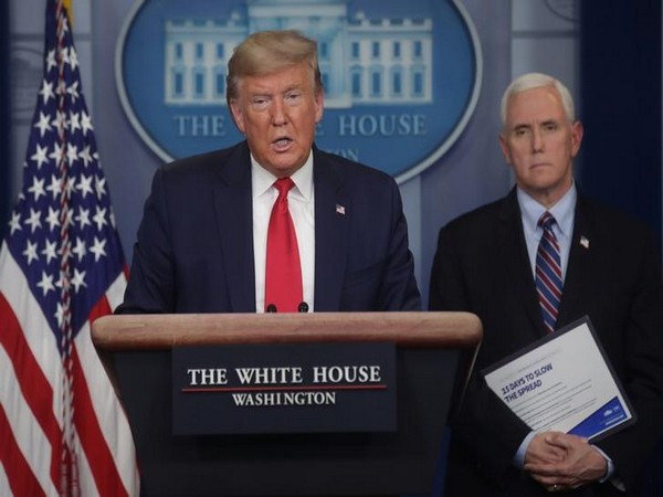 US President Donald Trump addresses the coronavirus task force daily briefing as Vice President Mike Pence stands by at the White House in Washington, US, March 26.