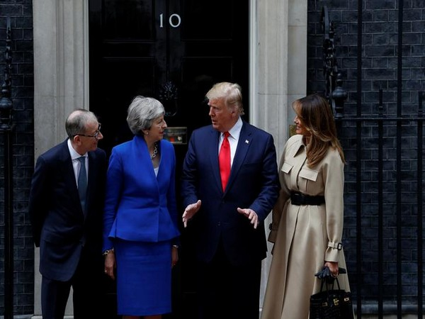 US President Donald Trump and First Lady Melania Trump meet Britain's Prime Minister Theresa May and her husband Philip at Downing Street on Tuesday