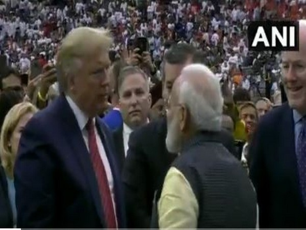 Prime Minister Narendra Modi and US President Donald Trump conversing amid a loud cheering crowd in Houston on Sunday