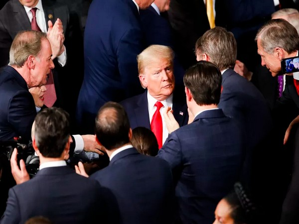President Donald Trump arrives to deliver his State of the Union address on Tuesday