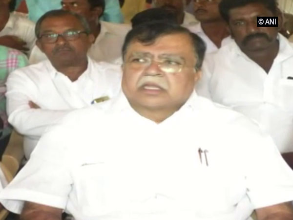 Senior Congress leader KN Rajanna addressing a public gathering in Tumkur, Karnataka on Monday.