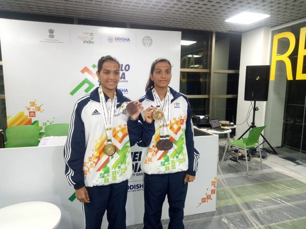 Identical twins Jyoti and Aarti, posing after winning a medal at the Khelo India University Games.