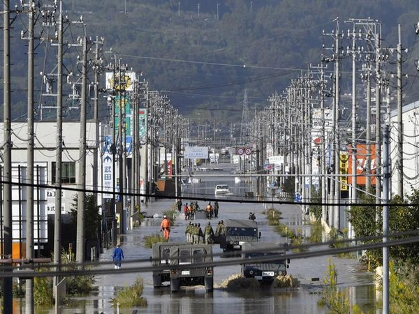 A residential area flooded by the Chikuma river, caused by typhoon Hagibis is seen in Nagano, central Japan on Sunday. (Photo/Reuters)