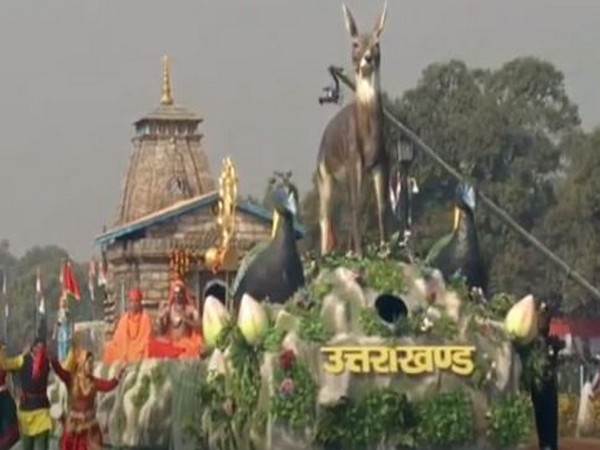 The front part of the tableau depicted the state's animal Musk Deer, bird Monal and flower Brahmakamal.