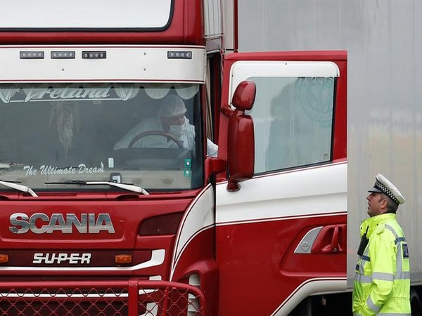 Police move the lorry container inside of which 39 bodies of migrants were discovered, in Grays, Essex, Britain on Wednesday