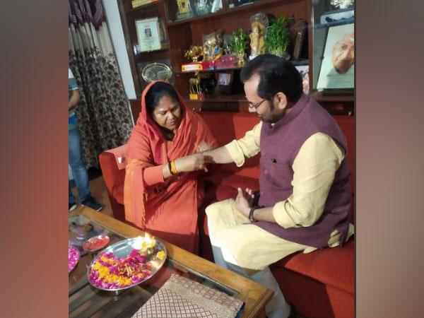 Union Minister Sadhvi Niranjan Jyoti ties rakhi to Union Minister Mukhtar Abbas Naqvi here on Thursday(Photo/ANI)