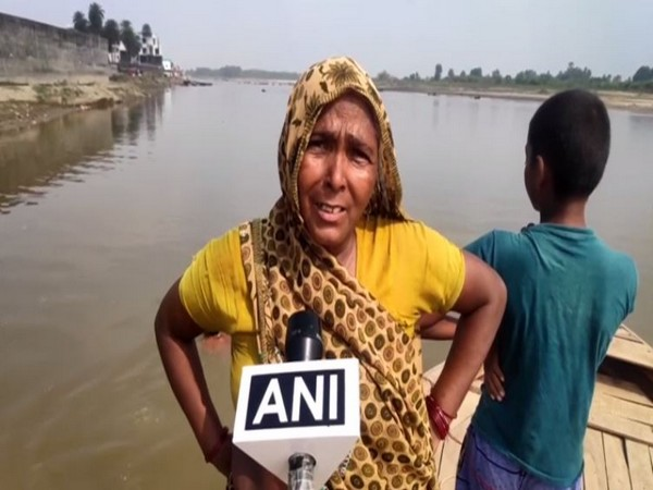 A woman speaking to ANI in Uttar Pradesh on Sunday. Photo/ANI