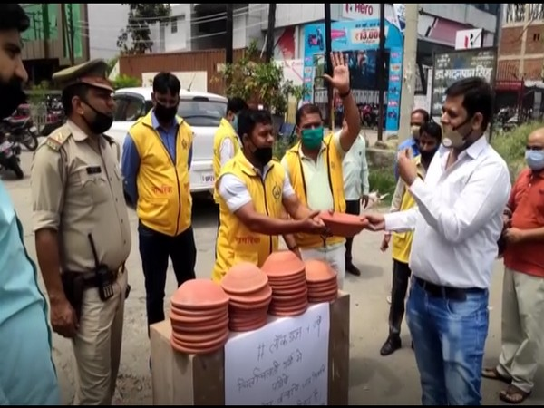 Civil Defence distributes earthen pots, asks people to provide water to birds amid high temperatures in Moradabad. (Photo/ANI)
