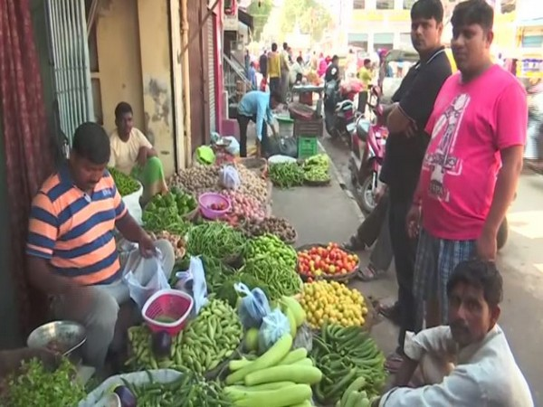 People buying vegetables in a local market in Varanasi in Uttar Pradesh on Tuesday. Photo/ANI
