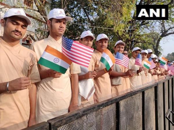 Students holding India and US flags to welcome US President Donald Trump in Gujarat. Photo/ANI
