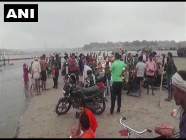 Devotees take holy dip in Triveni Sangam at Prayagraj. (Photo/ANI)