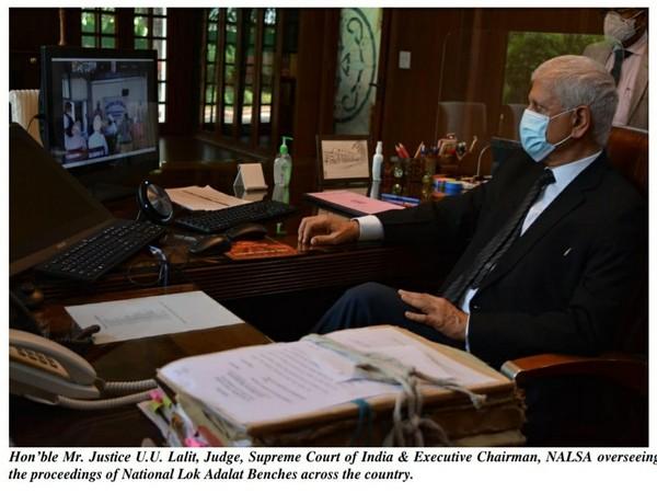 Justice U.U. Lalit, Executive Chairman of NALSA overseeing the proceedings of the National Lok Adalat. (Photo/ANI)