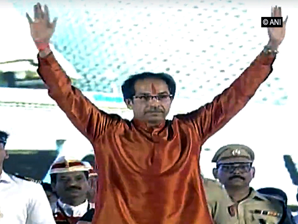 Chief Minister Uddhav Thackeray waiving at the crowd after taking oath here in Mumbai on Thursday. Photo/ANI
