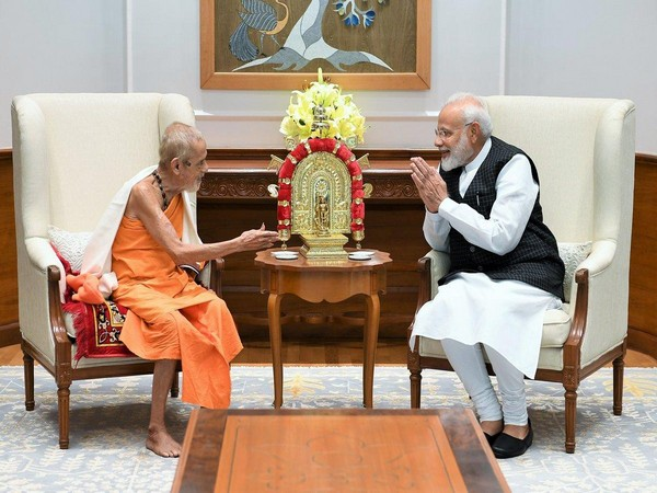 PM Narendra Modi with Vishvesha Teertha Swami of the Pejawara Matha in New Delhi on Tuesday, Photo/ANI