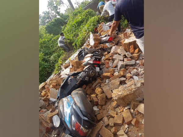 Several bikes were damaged after a rice mill wall collapses in Dhenkanal on Sunday. [Photo/ANI]