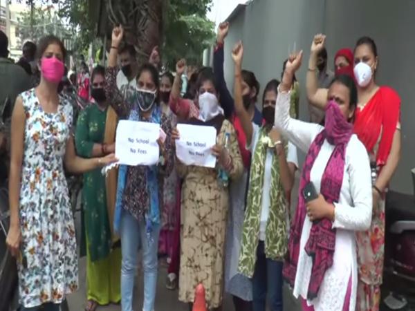Parents protest outside a school in Ludhiana. Photo/ANI