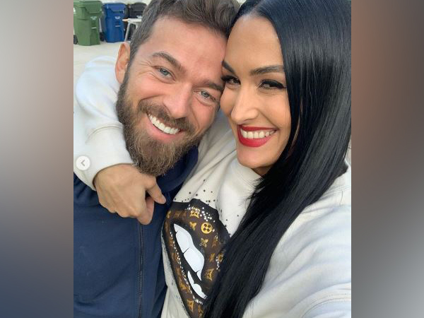 American television personality Nikki Bella with fiance Artem Chigvintsev. (Image Source: Instagram)