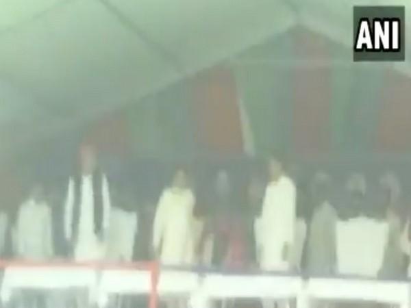 SP president Akhilesh Yadav, BSP president Mayawati and SP leader Dimple Yadav at a rally in Kannauj on Thursday. Photo/ANI