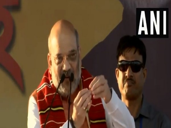 BJP president Amit Shah addressing a rally in Assam's Jorhat on Thursday. Photo/ANI