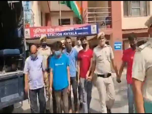 The Delhi Police with the arrested persons. (Photo: Twitter @DCPWestDelhi)