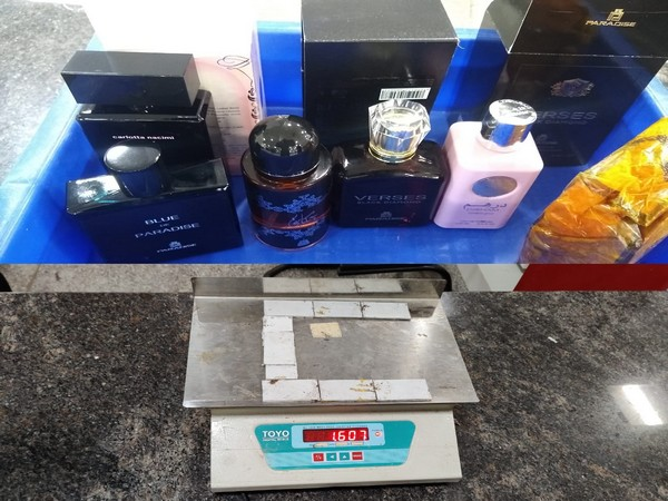Gold seised from perfume bottles and a battery case at Kozhikode International Airport.