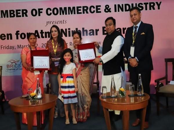 Usha Chaumar and Asha Jha being felicitated by Sonal Goel (IAS), Sasmit Patra, MP, Rajya Sabha and Sameep Shastri, Vice Chairman, BRICS CCI with BRICS CCI WE Rural Empowerment Awards