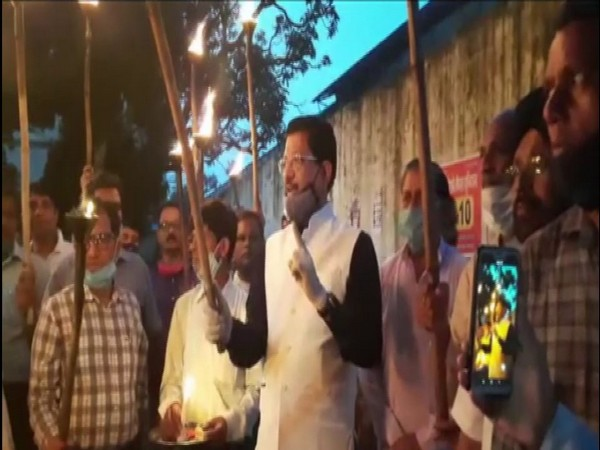 Uttarakhand Congress leader Suryakant Dhasmana during a torch rally in Dehradun on Friday. (Photo/ANI)