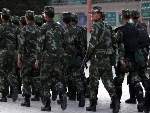 Armed police officers patrol an ethnice Uyghur area in Kashgar, in Xinjiang province. (Photo Credit - Reuters)