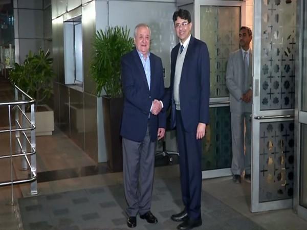 Uzbek Foreign Minister Abdulaziz Kamilov (L) arrives in New Delhi