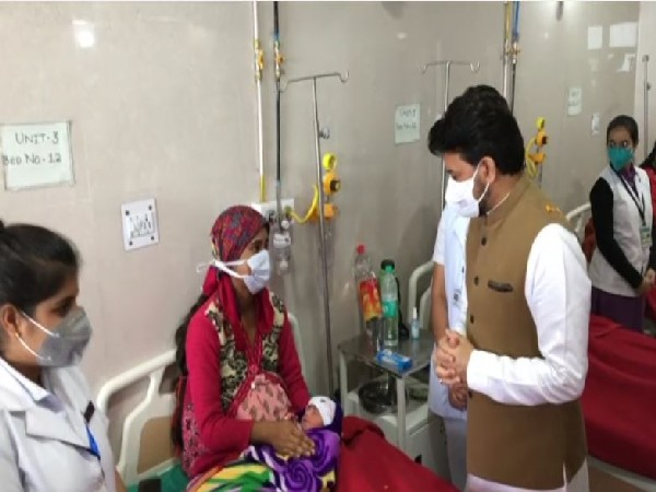 Union Minister Anurag Thakur meeting a patient. (Photos/ANI)