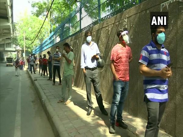 Long queue outside a vaccination centre in Ashok Nagar area in Delhi. (Photo/ ANI)