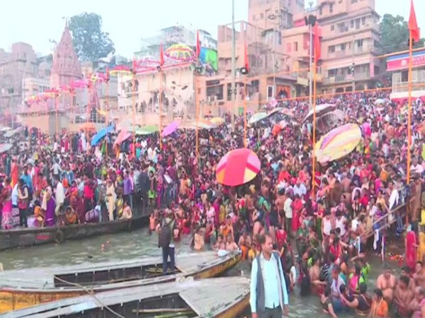 Hundreds of devotees took holy dip at Dashashwamedh Ghat on banks of river Ganga in Varanasi on Tuesday