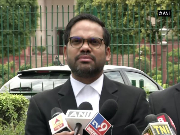 Varun Chopra, lawyer of Gujarat Congress leader Pareshbhai Dhanani, speaking to reporters in New Delhi on Tuesday.