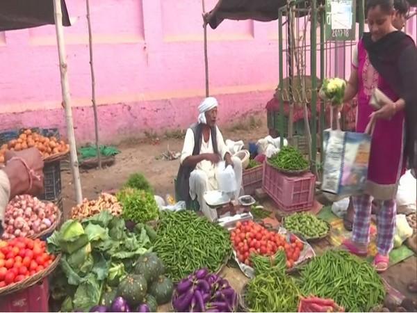 A vegetable vendor at Varanasi. Photo/ANI