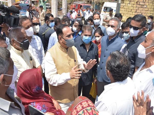Visual of Gujarat CM Vijay Rupani at Garal village of Una taluka (Photo/ANI)