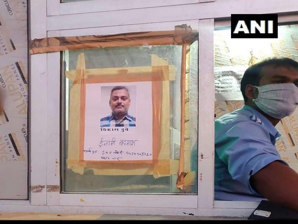 Photographs of history-sheeter Vikas Dubey, the main accused in Kanpur encounter case, have been put up at Unnao toll plaza. [Photo/ANI]