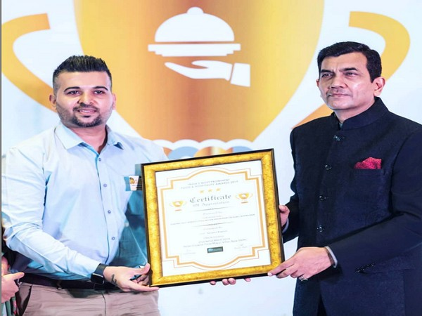 "Vikas Solanki receiving ""India's Most Prominent Food and Hospitality Award, 2019"" from Chef Sanjeev Kapoor"