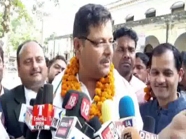 Congress candidate from Kaiserganj Vinay Kumar Pandey speaking to reporters on Thursday.