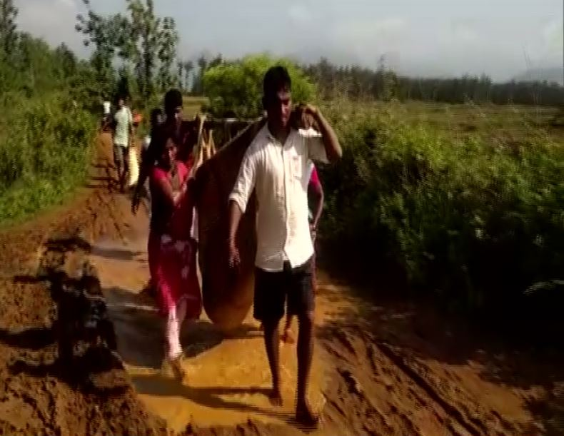 People carrying a pregnant woman to hospital on Sunday in Visakhapatnam, Andhra Pradesh.