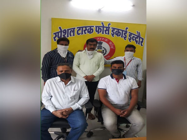 Indore STF arrested Vikas Bhandari (in yellow shirt) for allegedly being involved in a fraud of Rs 91 crore. [Photo/ANI]