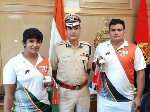 Manoj Yadava, Director-General of Haryana Police, with constables Baljit and Mohani.