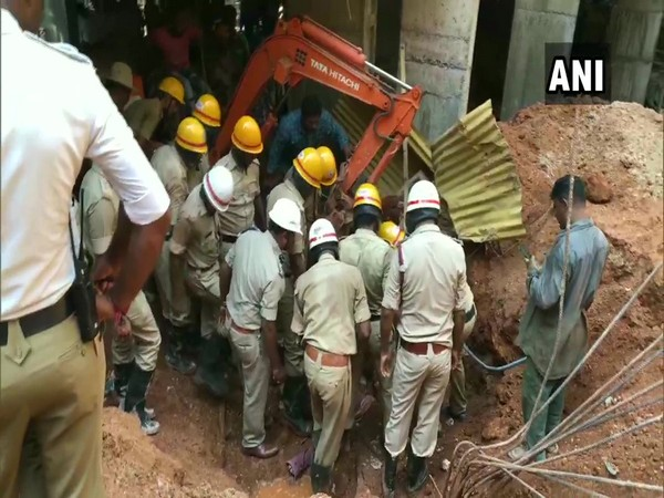 Fire officials conducting rescue work after a compound wall collapsed near a construction site in Mangaluru on Friday.