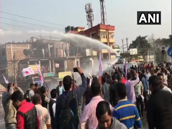 Police use water cannon to disperse the DYFI supporters in Siliguri in West Bengal on Wednesday. Photo/ANI