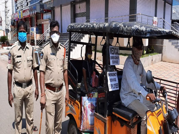 Police officers making arrangements of free auto service for needy people during full day curfew in West Godavari district. (Photo/ANI)