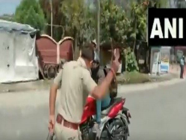 Police beats up a person found to be roaming in the streets without any credible reason