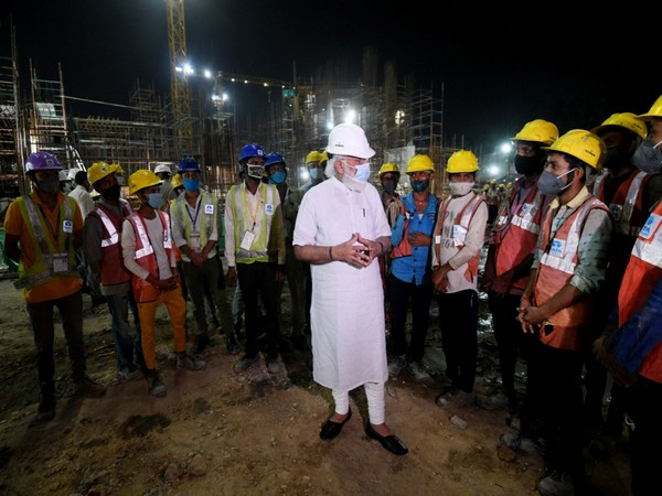 PM Modi interacts with workers engaged in the construction of the new Parliament building.