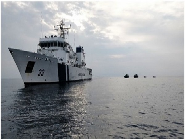 Indian Coast Guard offshore patrol vessel ICGS Vikram towing 2 crippled fishing boats