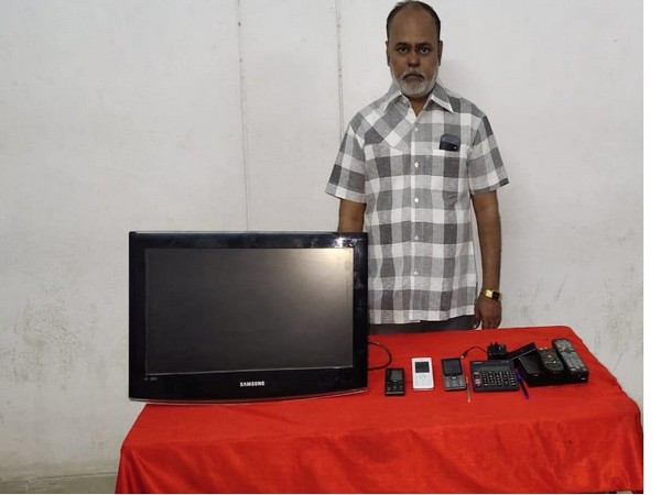 Accused Venkatesh Parashar  with the recovered items in Hyderabad on Monday. (Photo/ANI)