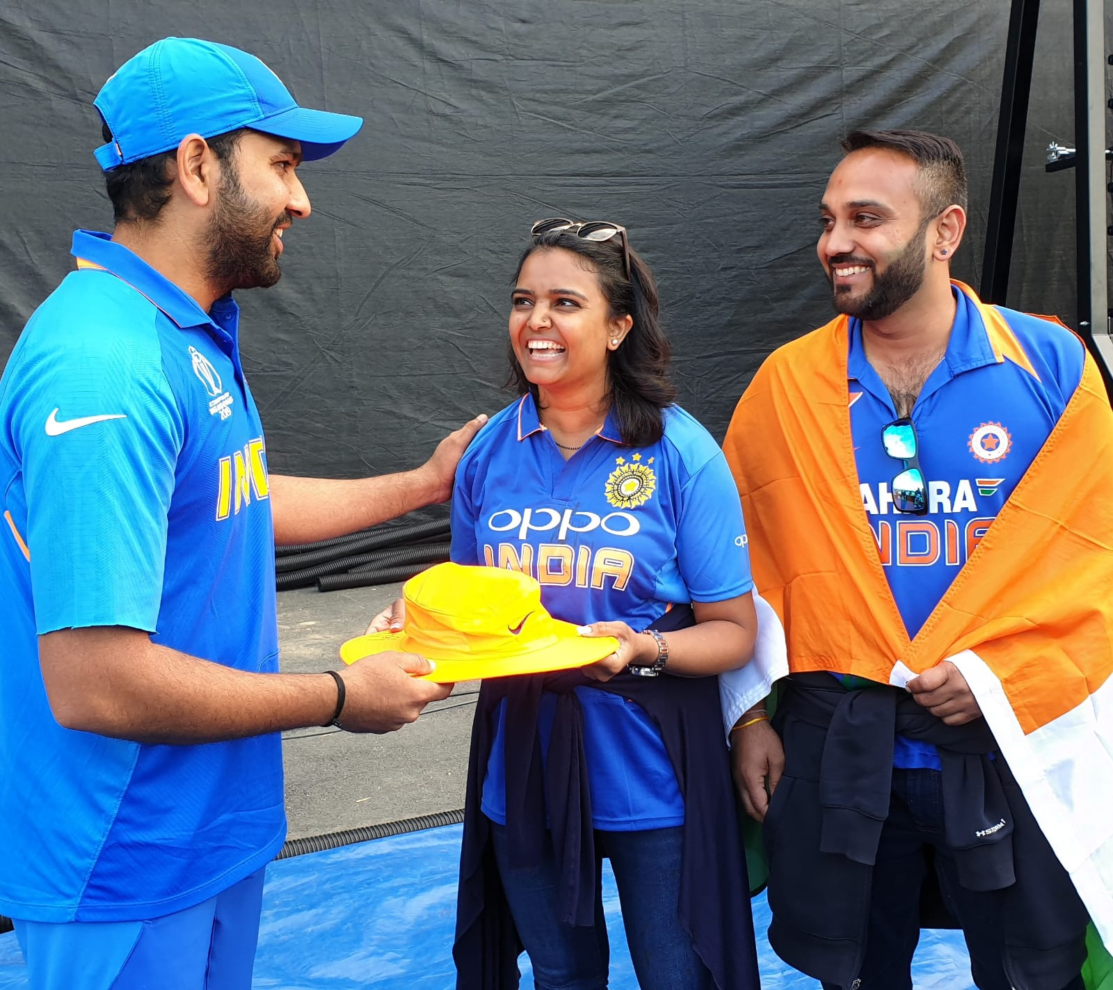 Rohit Sharma present an autographed hat to a fan, Meena, who was hit by the ball.